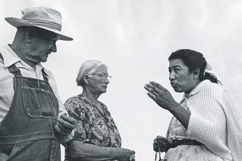 In this undated photo, labor leader Maria Moreno speaks with migrant farmworkers in rural California. A new film dives into the mystery around the Mexican American labor leader who organized farmworkers years before Cesar Chavez and Dolores Huerta and then disappeared from the public eye. (George Ballis/Take Stock via AP)