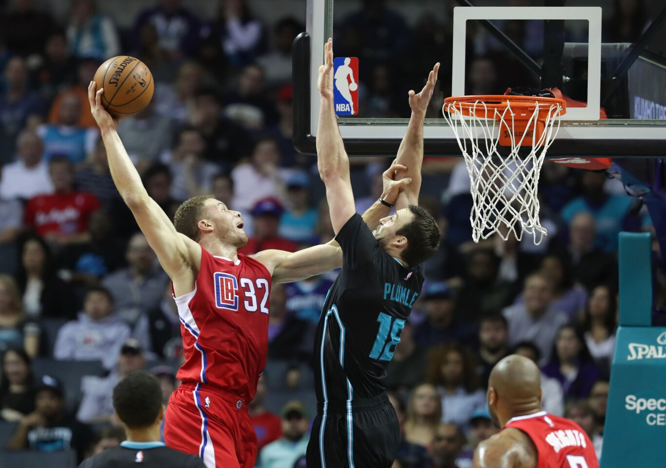 Clippers forward Blake Griffin dunks the ball over Hornets center Miles Plumlee during a game on Feb. 11.