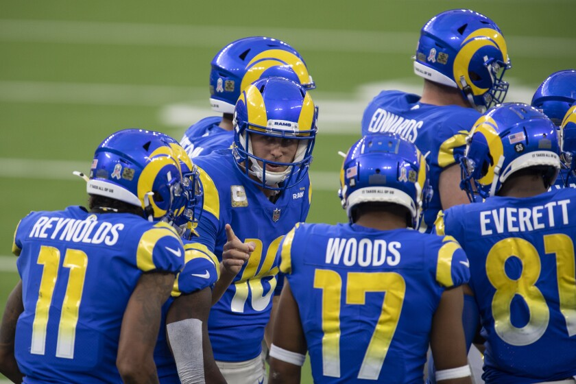 Los Angeles Rams quarterback Jared Goff (16) leads a huddle during an NFL football game against the Seattle Seahawks Sunday, Nov. 15, 2020, in Inglewood, Calif. (AP Photo/Kyusung Gong)