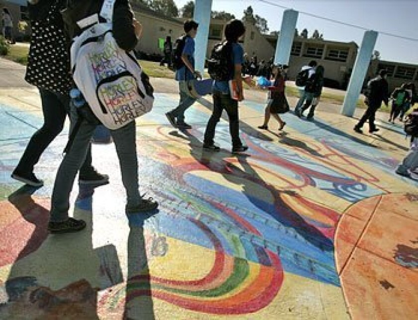In pre-pandemic days, students walk on the colorful sidewalks at the San Diego School of Creative and Performing Arts.