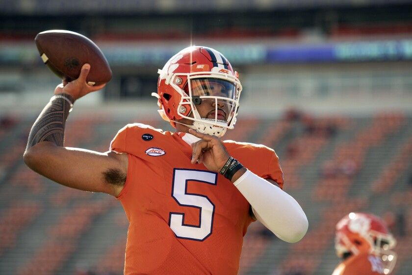 FILE - In this Oct. 31, 2020, file photo, Clemson quarterback D.J. Uiagalelei (5) warms up before an NCAA college football game against Boston College in Clemson, S.C. Uiagalelei finally has the national spotlight to himself. Uiagalelei and the No. 3 Tigers meet the fifth-ranked Bulldogs Saturday night in the Duke's Mayo Classic, a neutral site game in Charlotte, N.C. (Josh Morgan/Pool Photo via AP, File)