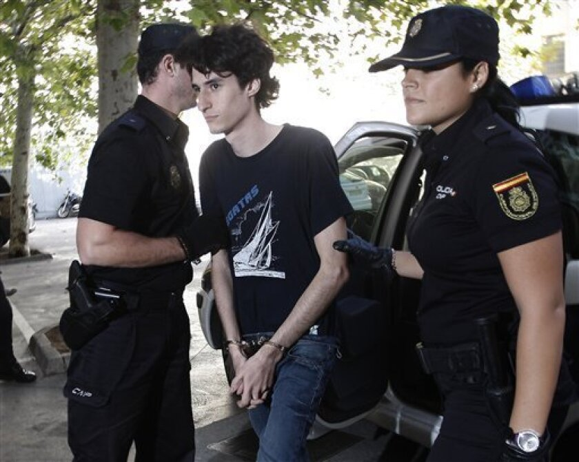 A Spanish man only identified by his initials J.M.M.S enters a court in Palma de Mallorca, Spain Friday Oct. 5, 2012. The man was arrested on suspicion that he planned to imitate the 1999 Columbine school killings by planting bombs around a university campus. In a statement, police said they seized 140 kilograms (308 pounds) of bomb-making material when they arrested the 21-year-old man in the Balearic island city of Palma de Mallorca on Wednesday. (AP Photo/Manuel Mielniezuk)