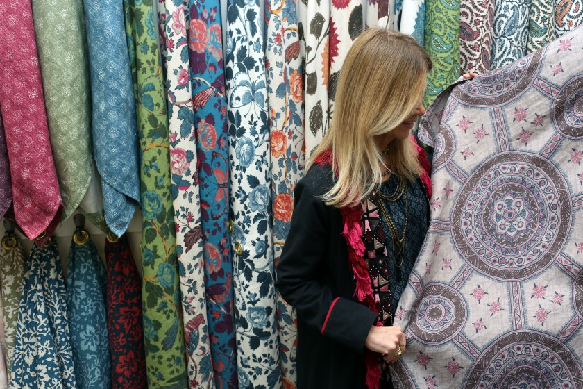 Schuyler Samperton examines her textiles hanging in the showroom at Hollywood at Home.