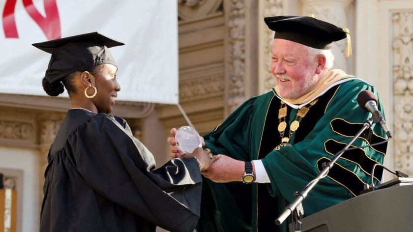 In 2013, Terry Burgess, then president of San Diego City College, was handing out commencement diplo