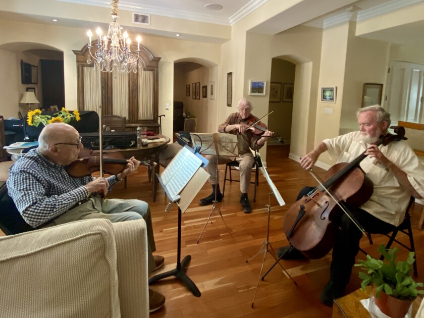 Martin Nass, Jack Clausen and Willis Frisch (from left) gather at Nass' condominium in La Jolla to play chamber music.