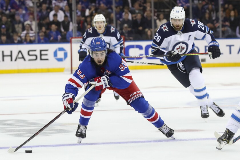 New York Rangers center Mika Zibanejad (93) skates next to Winnipeg Jets right wing Blake Wheeler (26) during the second period of an NHL hockey game Thursday, Oct. 3, 2019, at Madison Square Garden in New York. (AP Photo/Mary Altaffer)