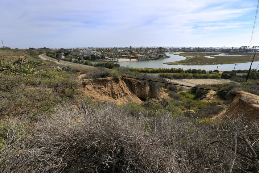 A view of the Army Corps of Engineers' mitigation and restoration area and the Newport Beach coastline as seen from site of the proposed Banning Ranch development.