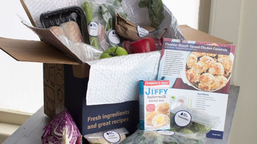 FILE - In this Oct. 6, 2014 file photo, an example of a home delivered meal from Blue Apron seen in