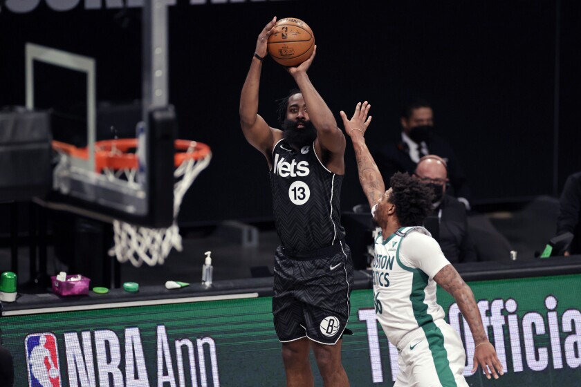 Brooklyn Nets guard James Harden (13) shoots over Boston Celtics guard Marcus Smart during the first half of an NBA basketball game, Thursday, March 11, 2021, in New York. (AP Photo/Adam Hunger)