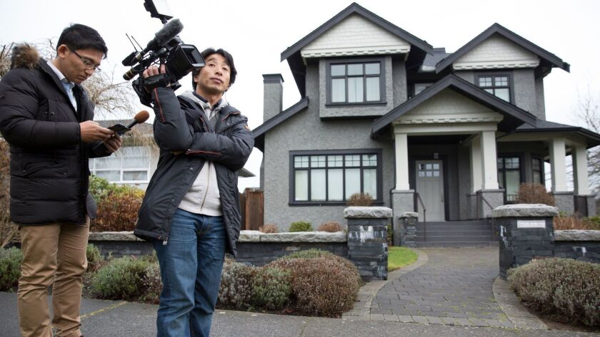 Members of the media wait outside the home of Huawei Technologies Chief Financial Officer Meng Wanzhou after she was released on bail in Vancouver, British Columbia in December.