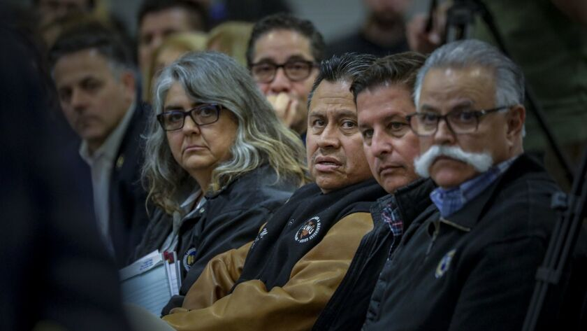Mark Mendoza, center, president of ILWU Local 13, spoke at a Harbor Commission hearing over whether to allow APM to use driverless electric cargo vehicles.