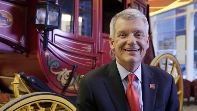 Why is this man smiling? Wells Fargo CEO Timothy Sloan, seen in March 2017.