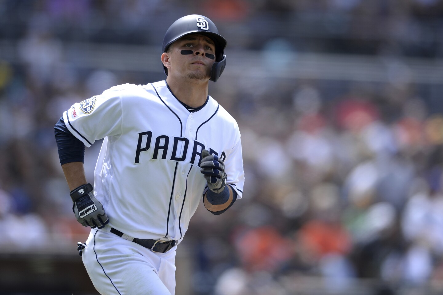 San Diego Padres' Luis Urias looks on as he runs to first base during the sixth inning of a baseball game against the Baltimore Orioles Tuesday, July 30, 2019, in San Diego. (AP Photo/Orlando Ramirez)