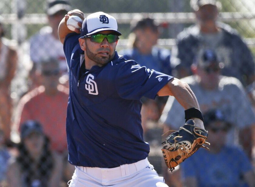 Padres catcher Wil Nieves fires a throw to second during drills prior to a spring training baseball game against the San Francisco Giants Tuesday, March 10, 2015, in Peoria, Ariz.