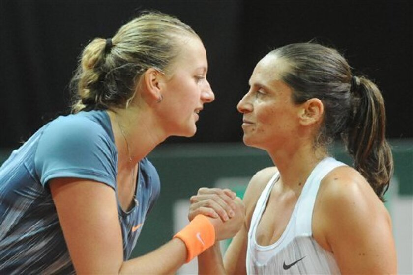 Winner Roberta Vinci of Italy, right, and Petra Kvitova of the Czech Republic shake hands after the final match at the WTA Katowice Open tennis tournament in Katowice, Poland, Sunday, April 14, 2013. (AP Photo/Alik Keplicz)