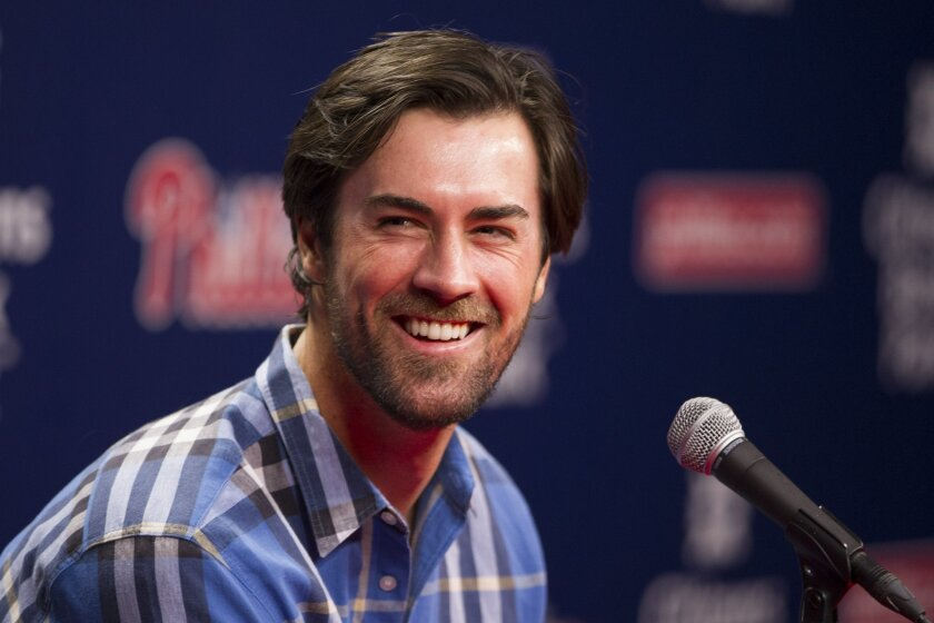 Former Philadelphia Phillies starting pitcher Cole Hamels takes questions from the media after being traded to the Texas Rangers prior to the first inning of a baseball game against the Atlanta Braves, Friday, July 31, 2015, in Philadelphia. (AP Photo/Chris Szagola)