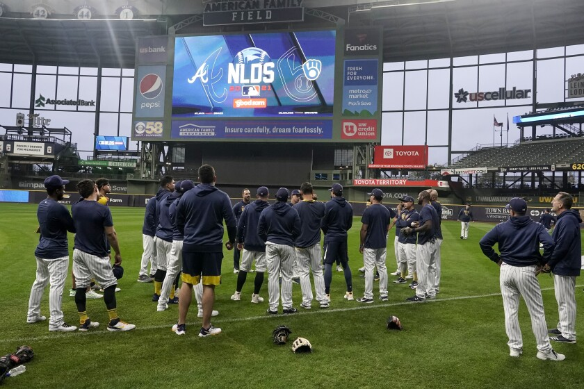 Milwaukee Brewers manager Craig Counsell talks to his players at a practice for the Game 1 of the NLDS baseball game Tuesday, Oct. 5, 2021, in Milwaukee. The Brewers plays the Atlanta Braves in Game 1 on Friday, Oct. 8, 2021. (AP Photo/Morry Gash)