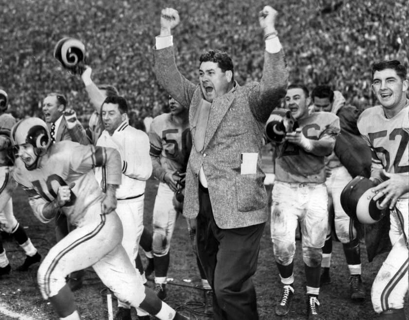 Coach Joe Stydahar and members of the Los Angeles Rams celebrate defeating the Cleveland Browns to win the 1951 NFL Championship at the Los Angeles Memorial Coliseum.