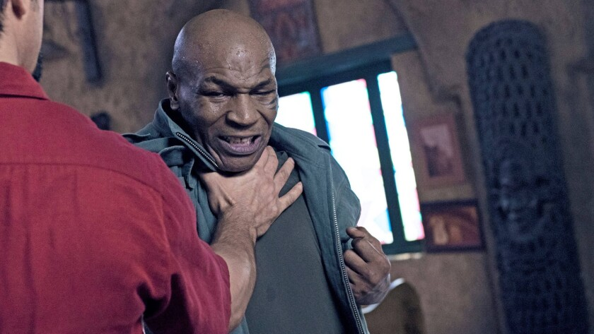 """Mike Tyson in a scene from """"China Salesman."""" Credit: Cleopatra Entertainment"""