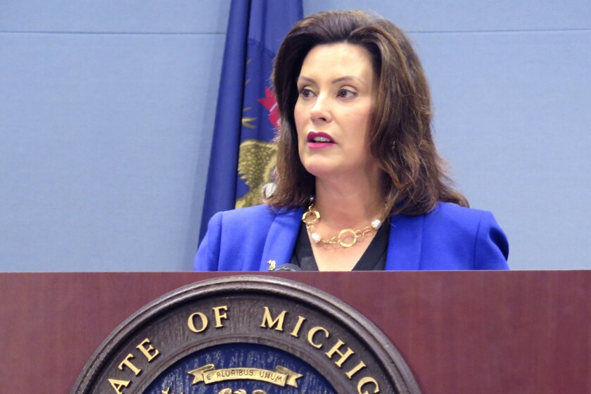 FILE - In this Aug. 28, 2019 file photo, Michigan Gov. Gretchen Whitmer speaks at a news conference in Lansing, Mich. Whitmer was expected to sign a $59 billion state budget on Monday night, Sept. 30, 2019, hours before the deadline to fund state government. But wrangling over the budget is likely far from over, as she was expected to use her line-item veto power to nix some spending proposed by the Republican-led Legislature. (AP Photo/David Eggert, File)