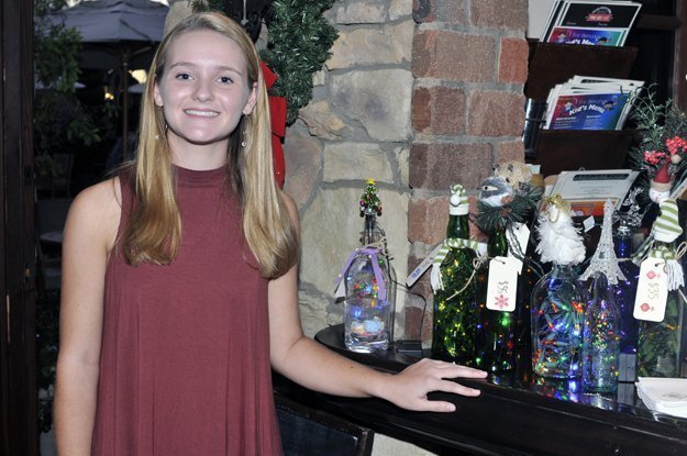 Event Founder Maranda Phillips and her Howliday bottle collection
