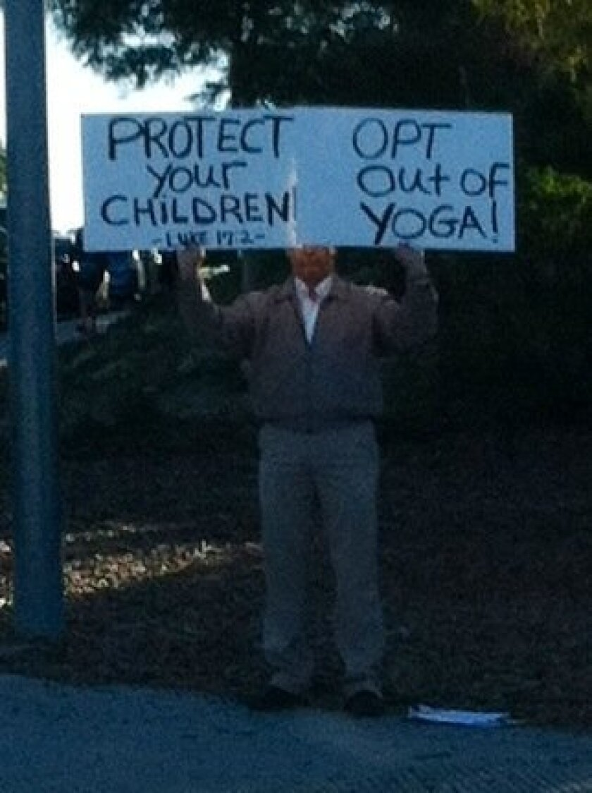 Craig Nordal stands outside of an Encinitas school.