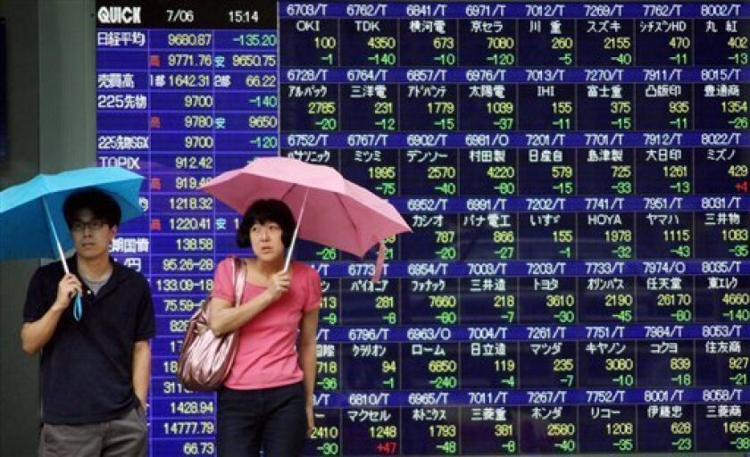 A couple under umbrellas pause in front of the electronic board of a securities firm flashing stock prices in Tokyo Monday, July 6, 2009. Japanese stocks extended losses for a fourth straight trading day Monday, pressured by dimming prospects for a swift recovery in the global economy and a sell-off of exporters amid a stronger yen. The benchmark Nikkei 225 stock average dropped 135.20 points, or 1.38 percent, to 9,680.87. (AP Photo/Koji Sasahara)