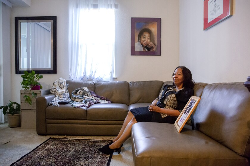 Lorraine Taylor on a sectional sofa in her Dublin, Calif., home.