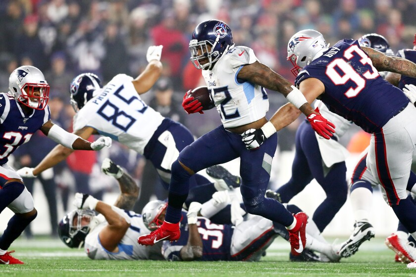 Titans running back Derrick Henry carries the ball during his team's 20-13 playoff win Jan. 4, 2020.