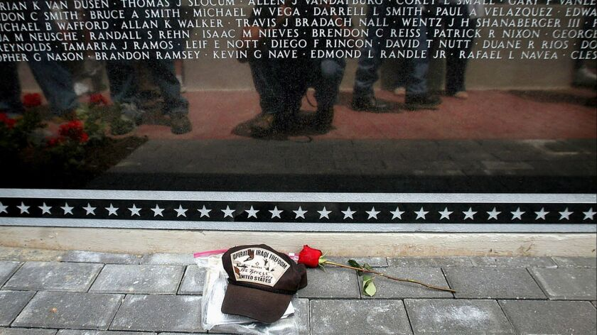 **ADVANCE FOR MONDAY, MAY 29 - FILE** People are reflected in the Middle East Conflicts Wall Memoria