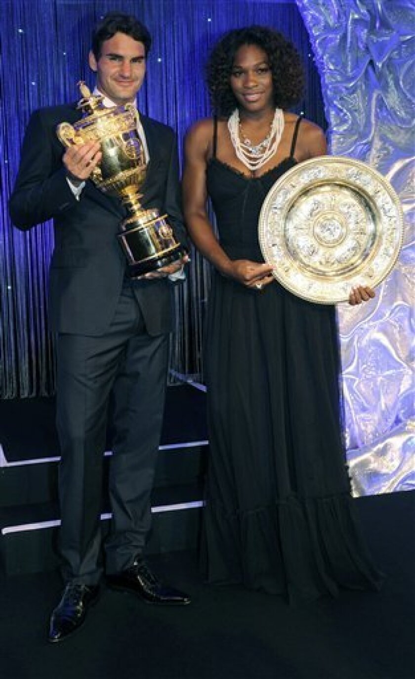 Wimbledon champions Roger Federer, left, and Serena Williams pose together during the Champions Dinner at the Hotel Intercontinental, in London on Sunday July 5, 2009. (AP Photo/Rebecca Naden, PA)