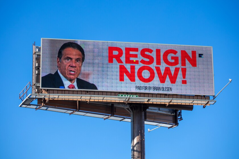A billboard urges New York Gov. Andrew Cuomo to resign.