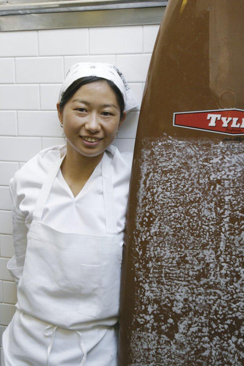 Kuniko Yagi, in the kitchen at Sona, will be chef of Hinoki and the Bird in Century City.