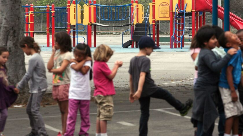 LOS ANGELES-CA-JUNE 9, 2014: Students line up across from the playground at Citizens of the World Ch