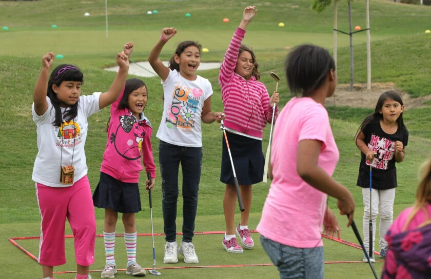 "Pro Kids The First Tee San Diego (Oceanside Campus)- Kids cheer a teammate who just won a ""Golf Billiards"" game."