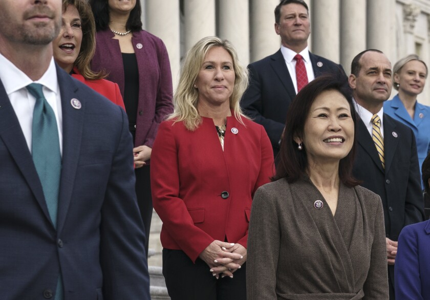 In this Jan. 4, 2021, photo, Rep. Marjorie Taylor Greene, R-Ga., center, stands with other GOP freshmen.