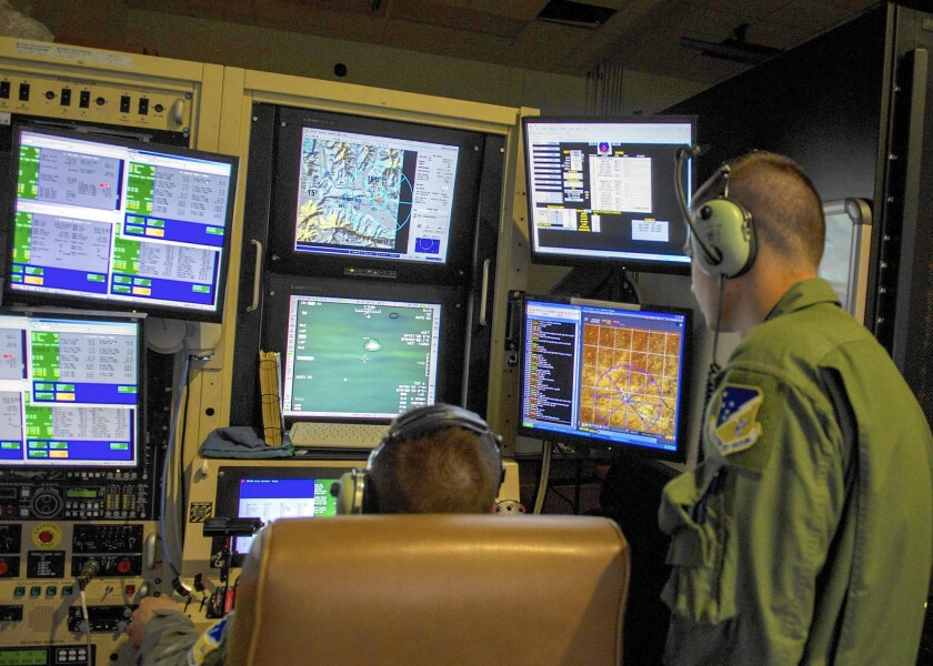 Air Force pilots train on a drone simulator.