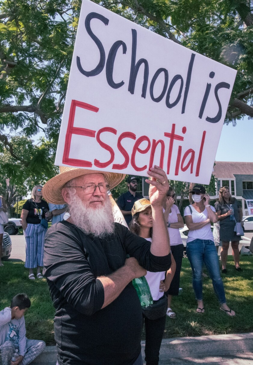 A protester at the Orange County Board of Education office in Costa Mesa.