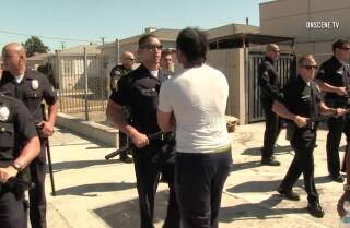 Residents confront LAPD after fatal shooting