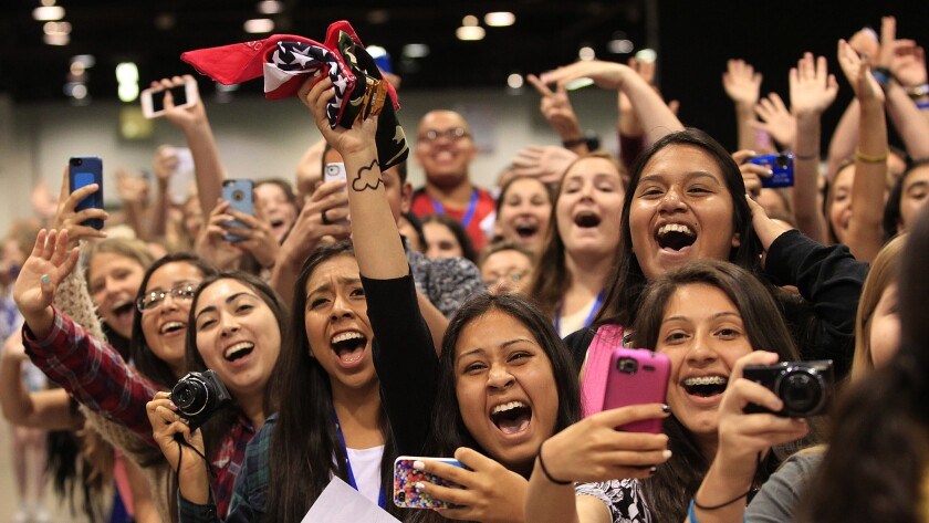 Fans cheer as their favorite YouTube stars from Our2ndLife arrive for a photo and autograph session during the three-day VidCon convention at the Anaheim Convention Center.