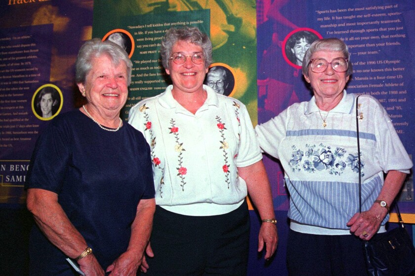 Former women's pro baseball players Mary Pratt, left, and Maddy English, right, are joined by friend Marie Cronin in 1999.