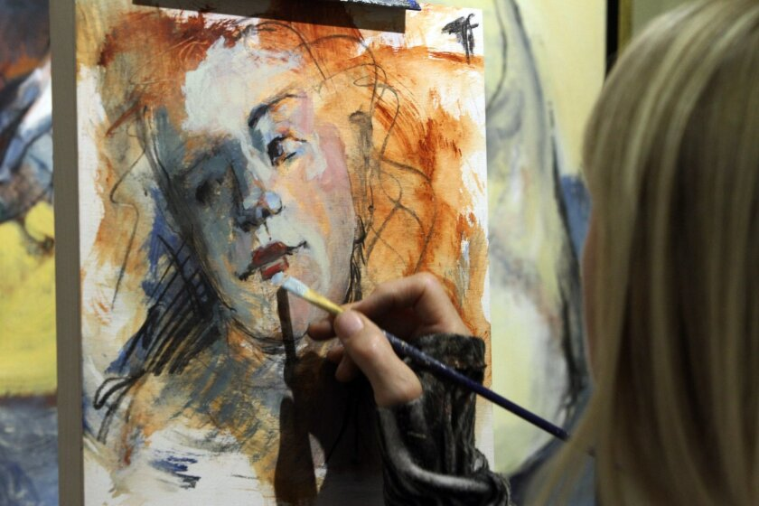 Artist Catherine Edlinger-Kunz paints in acrylics Saturday during the Art-A-Thon. Photo by Bill Wechter