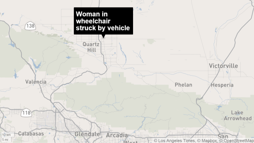 A 30-year-old woman riding a motorized wheelchair on a highway in Lancaster died after being struck by a vehicle, authorities said.
