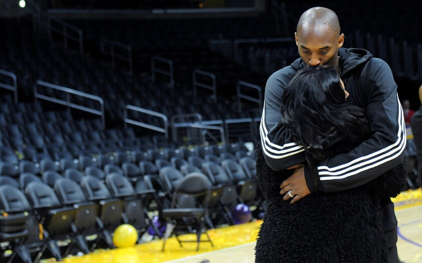 Kobe Bryant kisses his wife Vanessa long after his last game at Staples Center.