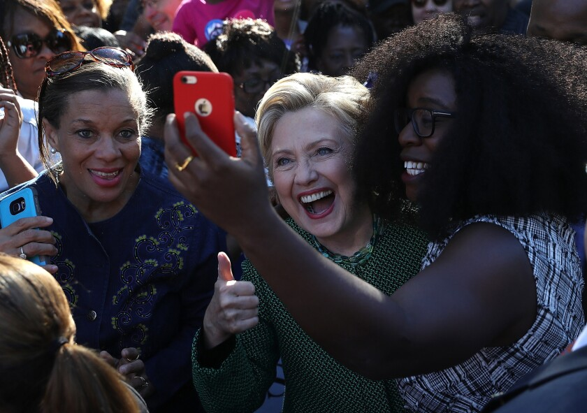 Hillary Clinton takes a selfie with early voters at Chavis Community Center in Raleigh, N.C., on Sunday. The contest in North Carolina remains close, and Clinton is depending on a large turnout of black voters.