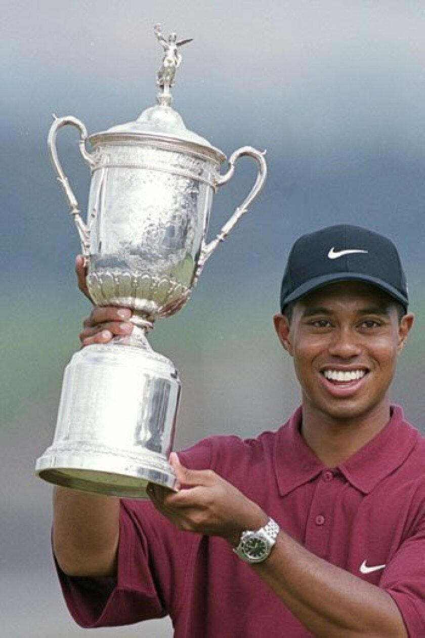 Tiger Woods hoists the trophy after winning the 2000 U.S. Open in Pebble Beach. Jamie Squire/Allsport