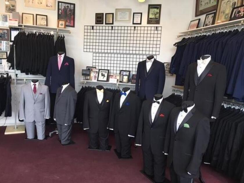 Walls and shelves are adorned with photos of longtime customers and celebrity patrons of A Better Deal Tuxedos & Suits, 369 Bird Rock Ave., off La Jolla Boulevard, in La Jolla. (858) 551-6044, abetterdealtuxedo.com