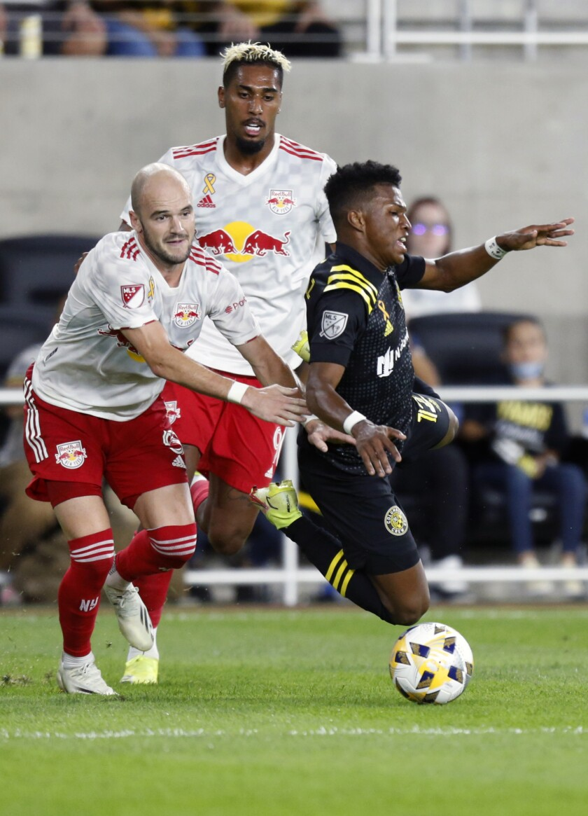 New York Red Bulls defender Andrew Gutman left, and forward Fabio work for the ball behind Columbus Crew midfielder Luis Diaz during the second half of an MLS soccer match in Columbus, Ohio, Tuesday, Sept. 14, 2021. The Crew won 2-1. (AP Photo/Paul Vernon)