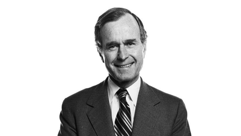 Then-presidential candidate George H.W. Bush poses for a photo at the Los Angeles Times building on Jan. 1, 1980.