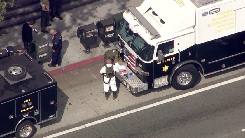 Hazmat vehicles stopped outside the Stanley Mosk Courthouse on Thursday.